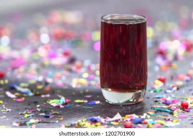 Abstract, blur, bokeh background, defocusing - image for the background.Whiskey in a glass