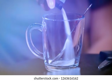 Abstract, blur, bokeh background, defocusing - image for the background. Take your medication. The girl takes drinking water. Woman hold pill blister. The concept of flu and cold