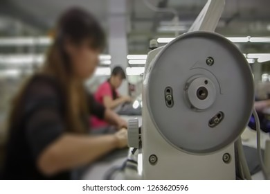 Abstract, blur, bokeh background, defocusing - image for the background. People work in the clothing industry.