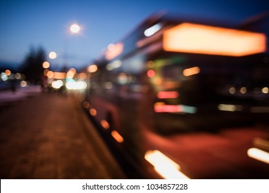 abstract blur bokeh background: public transportation bus is approaching a bus stop, abstract background