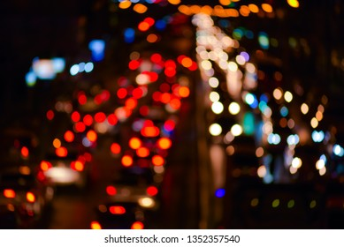 abstract blur bokeh of evening traffic jam on road in city