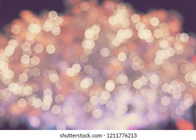 abstract blur bokeh glittering lights - blurred background concept
