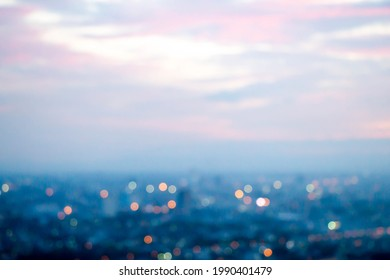 abstract blur bokeh of night light city with mountain and sunset sky background