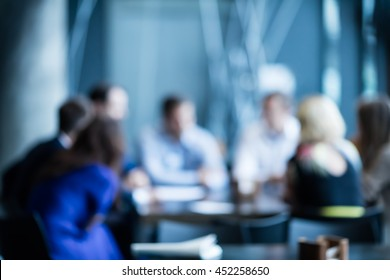 Abstract blur Business meeting, business, press, news and people and concept - close up of young smiling businessman reading newspaper over office building