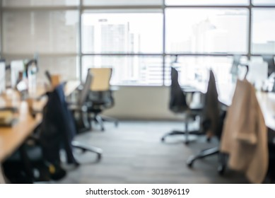 Abstract blur business office working space background with modern interior table and chair with devices. Blurry creative workplace design background