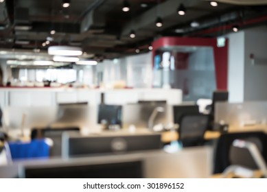 Abstract blur business office working space background with modern interior table and chair with devices. Blurry creative workplace design background. laptop and mouse