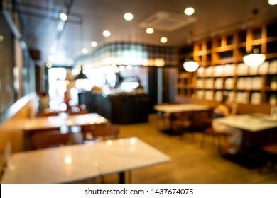 abstract blur cafe restaurant for background - vintage effect filter