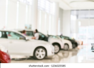 Abstract blur of car in the showroom background