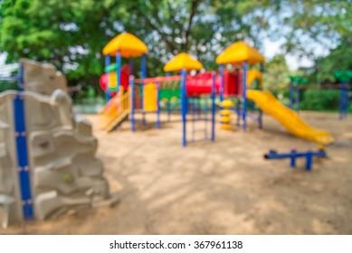 Abstract blur children playground in city park background