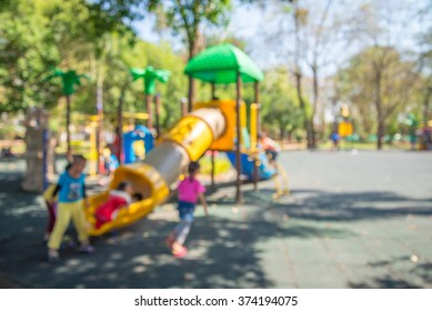 Abstract blur children playground in city park background in sunny day