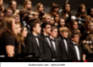 Abstract blur of choir singing while performing during live concert.