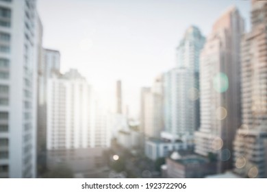 Abstract blur city estate buildings in morning view background. Cityscape skyline from top office window view. Blurred outside bokeh real architecture modern company construction town morning outdoor.