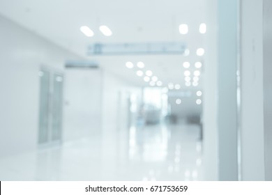 Abstract blur Clinic or hospital interior for  beautiful luxury backgrounds , Deep corridor, detail of a white corridor in a hospital