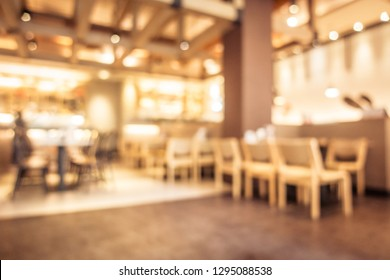 Abstract blur coffee shop cafe interior for background