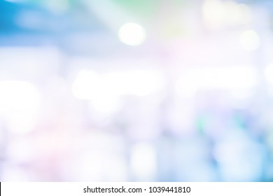 abstract blur contemporary office interior blue background with orange light filter effect