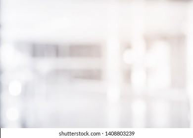 abstract blur contemporary office interior white background with morning shine light effect concept