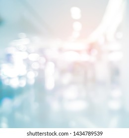 abstract blur contemporary office interior blue square size background with orange shine light effect concept