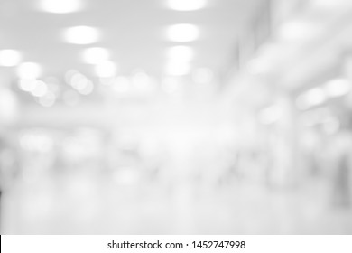 abstract blur corridor perspective indoor of opening hall background with bulbs light for design