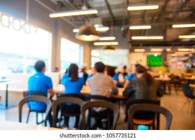 Abstract Blur or Defocus Background of Businesspeople, men and Women, Meeting over Wooden desk in co-working Space or Food Restaurant as Business Collaboration Partnership Teamwork Briefing Concept.