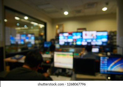 Abstract Blur or Defocus Background of Dark Broadcasting room in Television Station including Monitor and control System for Broadcast Media.