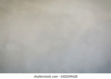 Abstract Blur Defocus Background of grey or Dark Polish Cement Wall with Dramatic Lighting style show Vignette and Soft focus