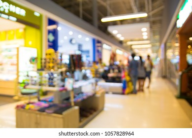 Abstract Blur or Defocus Background of People Shopping in Department Store Shopping Plaza Retail Outlet at Corridor with Booth kiosk as Modern City Lifestyle Concept