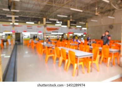 Abstract Blur or Defocus Background of People in Traditional Food Center with Bokeh as Modern Urban Lifestyle Concept.