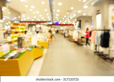 Abstract Blur or Defocus Background of People shopping in Community Mall or Department Store.