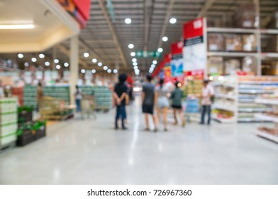 Abstract Blur Defocus Background of People Shopping in in Supermarket Hypermarket Retail or Store outlet Between big Aisle of any Section as Retail Business Concept