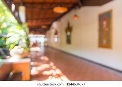 Abstract Blur or Defocus Background of Walkway or building Corridor with Sunshine morning and Ancient Thai Style Decoration.
