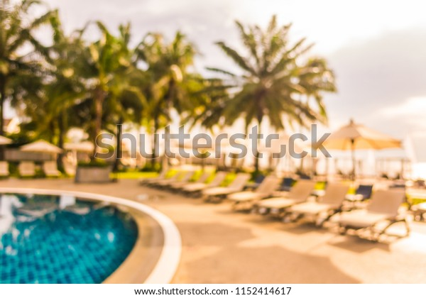 Abstract blur and defocused beautiful outdoor swimming pool in hotel and resort for travel and vacation