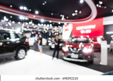 Abstract blur and defocused car and motor exhibition show interior for background