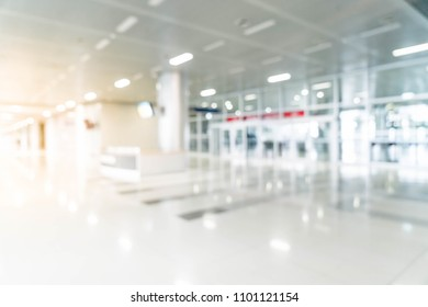abstract blur and defocused in empty office building with glass window and copy space for background