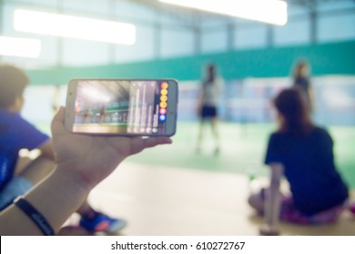 abstract blur Facebook live at badminton court