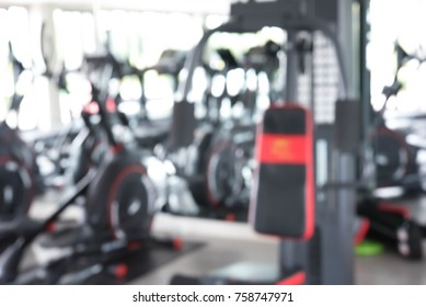 Abstract blur fitness and sport equipment in gym interior to represent the blurred background.