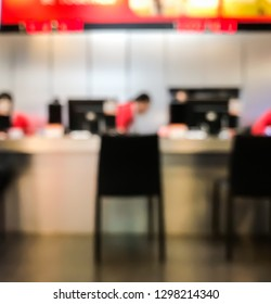 Abstract blur focus empty chair front of counter service  in payment shop