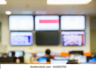abstract blur focus LED TV use monitor network in Network Operating Center room - Shutterstock ID 412035703