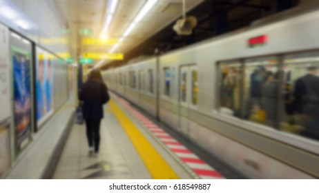 abstract blur: girl with black cloth walking at train station  background from tokyo japan