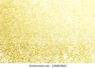 Abstract blur gold glitter christmas event celebration card design background concept - shiny light dust sparkle festive decoration effect, smooth holiday texture golden wallpaper, happy new year 2019