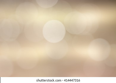 abstract blur gold metallic surface background concept with bokeh light.