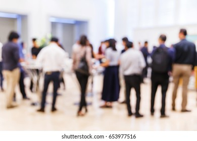 Abstract blur group of people in business conference seminar event, blurry businessman, corporate meeting concept