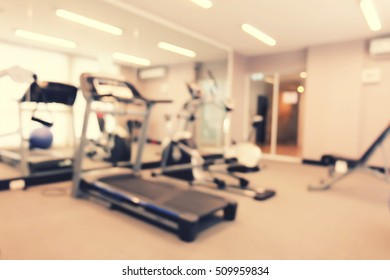 Abstract blur gym and fitness room interior for background.