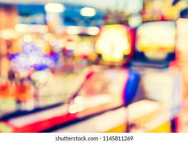 Abstract blur image of Arcade Game Machine Shop with bokeh for background usage . (vintage tone)