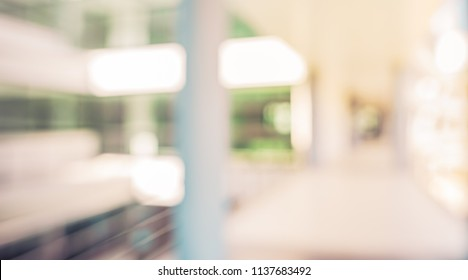 Abstract blur image of  Building with bokeh for background usage . (vintage tone)