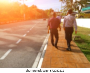 Abstract blur image of business man walked in the city on sunny day