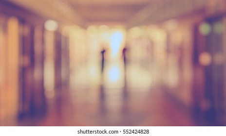 Abstract Blur image of corridor and people with bokeh for background usage .