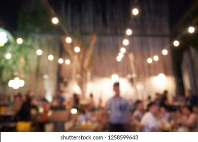 Abstract blur image customer dinner hang out or enjoy in the restaurants on friday night and The atmosphere is happy and relaxing with bokeh for background, celebration and night life in city concept.