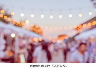 Abstract blur image of  Day  Festival on street with bokeh  for background usage .(vintage tone)