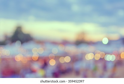 abstract blur image of day festival for background usage. (vintage tone)