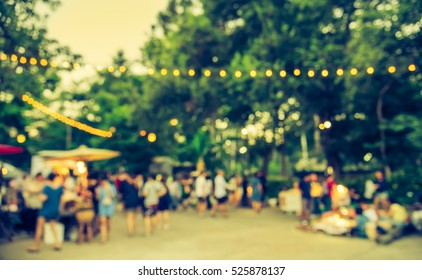 abstract blur image of  day festival  in garden with bokeh for background usage .(vintage tone)